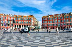 Panoramic view of tourists and the Fontaine du Soleil on Place Massena stock photography