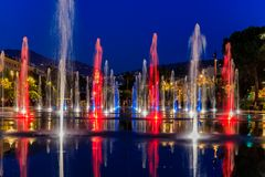 Reflecting fountain on Promenade du Paillon in Nice France. Nice, France - May 25, 2018: Reflecting fountain on Promenade du Paillon, surrounded by a green urban royalty free stock photos