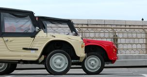 Two Citroen Mehari - Side View. Nice, France - May 21, 2019: Two Citroen Mehari, French Retro Cars Side View Parked In A Parking Lot In Nice On The French stock video footage