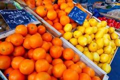 Nice, France - October 17, 2011: Juicy oranges and lemon, fresh citrus fruits. At fruit market royalty free stock photo