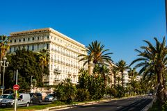 Nice, France - 2019. Promenade des Anglais, with palm trees seven kilometers along the coast a place of rest walking and sport by. The sea in of the Cote d`Azur royalty free stock images