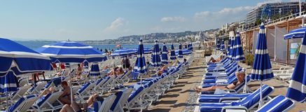Blue Umbrellas on the Beach at Nice France royalty free stock photography