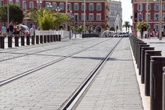 NICE, FRANCE - SEPTEMBER 02, 2017: Contemporary tram rail on Place Massena - one of the main city squares Stock Photos
