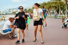 Nice, France - September 23, 2018: Promenade near the sea and the people on it in Nice in France. In a good day stock images