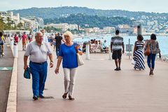 Nice, France - September 23, 2018: Promenade near the sea and the people on it in Nice in France. In a good day royalty free stock photo