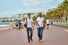 Nice, France - September 23, 2018: Promenade near the sea and the people on it in Nice in France. In a good day stock photo
