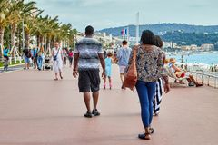 Nice, France - September 23, 2018: Promenade near the sea and the people on it in Nice in France. In a good day stock photos