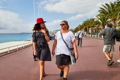 Nice, France - September 23, 2018: Promenade near the sea and the people on it in Nice in France. In a good day royalty free stock image