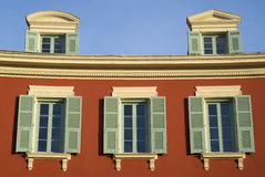 Nice, France. Windows on the facade of an historical house Stock Image
