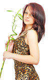 Nice fresh girl with bamboo in hands Royalty Free Stock Image