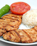 Nice fryied Chicken with rice and tomato. Nice fryied Chiken with rice and tomato with green pepper Stock Photos