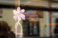 Nice and funny gift flower. Funny little handmade flower behind a gift shops window Stock Photo