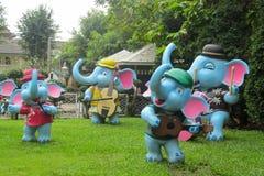 Nice garden figure of smiling dancing elephants. In nthe green grass garden Stock Image