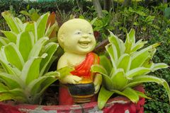 Nice garden figure of a smiling monk in asia. Country Royalty Free Stock Photos