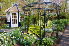Nice garden house with chairs royalty free stock photos
