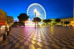 Nice giant ferris wheel and Massena square evening view. Alpes-Maritimes region of France stock image