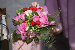 Good gift with a bouquet of flowers Stock Photos