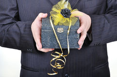Nice gift chest in hands of businessman Stock Photo