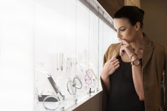 Nice girl in ambient light , looking jewels royalty free stock photo
