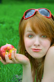 Nice girl with apple Royalty Free Stock Images