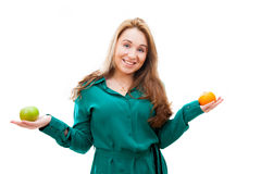 Nice girl with apple and tangerine Royalty Free Stock Images