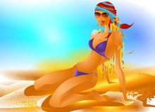 Nice Girl on the Beach. A nice ideal girl in bikini sitting down in the sand in a warm atmosphere Royalty Free Stock Images