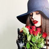 Nice Girl. Beautiful Woman with Rose Flowers Stock Photography