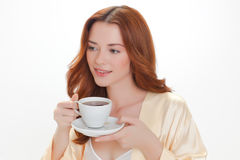Nice girl in beige home dressing gown Stock Photography