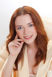 Nice girl in beige home dressing gown Royalty Free Stock Photo