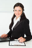 Nice girl in a black business suit Stock Photography