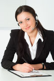 Nice girl in a black business suit with a white Royalty Free Stock Photo