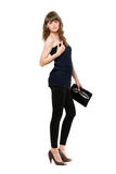 Nice girl in black leggings with a handbag Stock Images