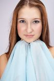 Nice girl with blue scarf. Nice teenager with blue scarf in her hands Stock Images