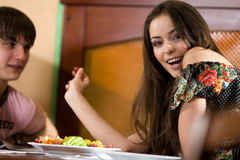 Nice girl and boy at table together Stock Image