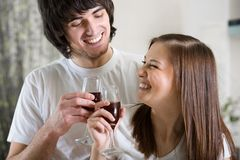 Nice girl with boy with wineglasses Stock Photography