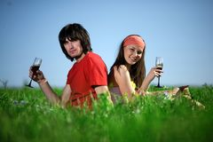 Nice girl and boy with wineglasses Stock Images