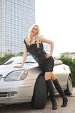 Nice girl with cabriolet car. Nice girl in a black frock with cabriolet car on a street royalty free stock images