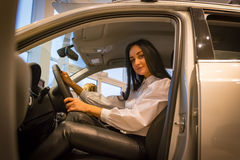 Nice girl in a car shop Stock Image