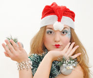 Nice girl with christmas toys Royalty Free Stock Images