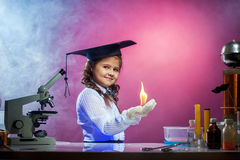 Nice girl conducting physical experience in lab. Oratory Stock Photography