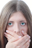The nice girl covering a mouth palms. Portrait of the nice girl covering a mouth palms removed close up Stock Photo