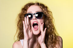 Nice girl with curly hair screaming Stock Images