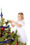 Nice girl decorates a Christmas tree Stock Image