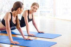 Nice girl doing exercises on the floor Royalty Free Stock Images