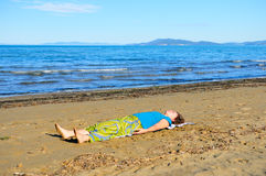 Nice girl doing yoga excercise on the beach Royalty Free Stock Photo