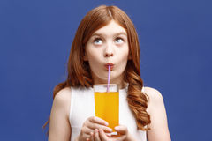 Nice girl drinking orange juice Royalty Free Stock Photography