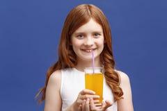 Nice girl drinking orange juice Stock Photo