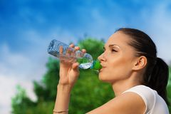 Nice girl drinking water from bottle Royalty Free Stock Image