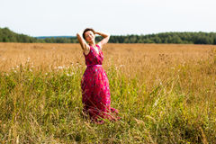 Nice girl and a field Royalty Free Stock Images