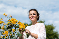 Nice girl and flowers. In a nice day Stock Images